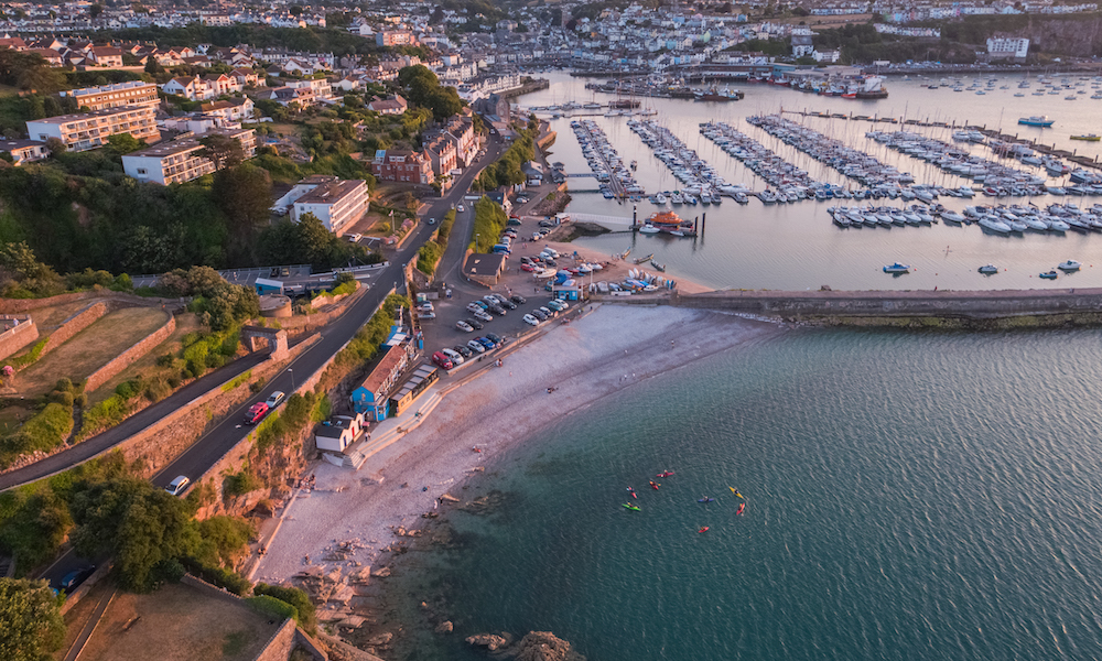 Breakwater beach at sunset in Brixham, Devon