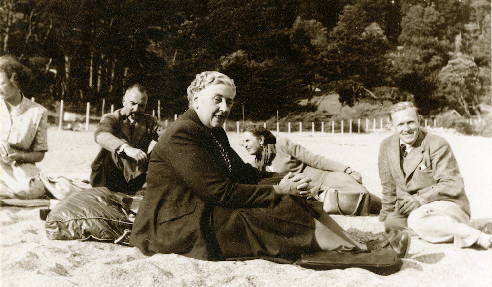 Agatha Christie sat at the beach in Torquay